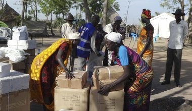 Women recieve boxes of Fishing Kits distributed by FAO
