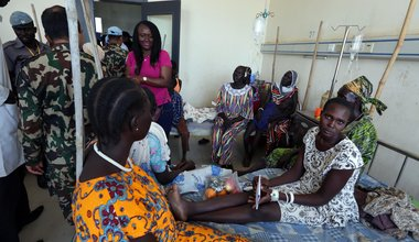 UNMISS staff members donate food and clothes at a women's hospital in Rumbek