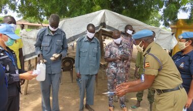 UN police officers in Rumbek distribute face masks and soap to South Sudanese colleagues