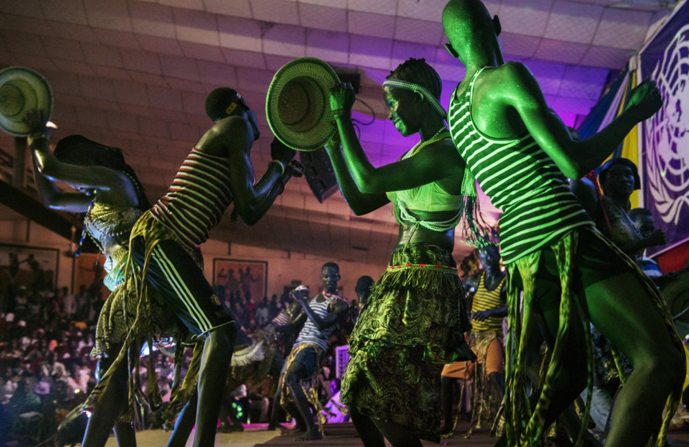 "The Kush Dance Group performs during the ""Comedy for Peace"" event, supported by the United Nations Mission in South Sudan (UNMISS), at the Nyakuron Cultural Centre on Sunday, 23 April in Juba."