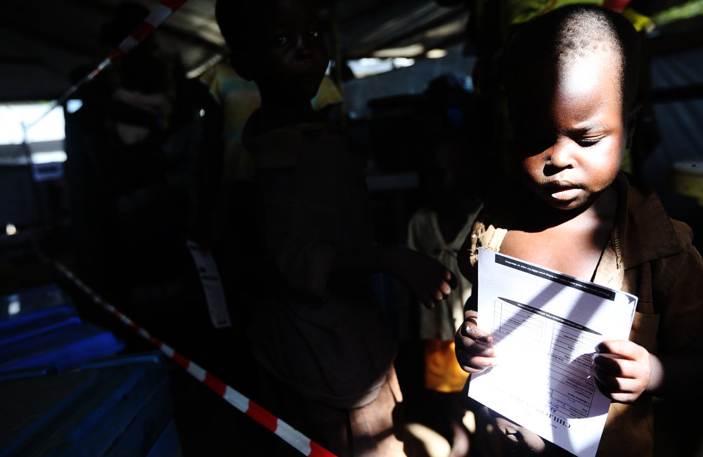 A young child waits to be inoculated at the Imvepi refugee camp reception center in Northern Uganda on Friday, 23 June, 2017.
