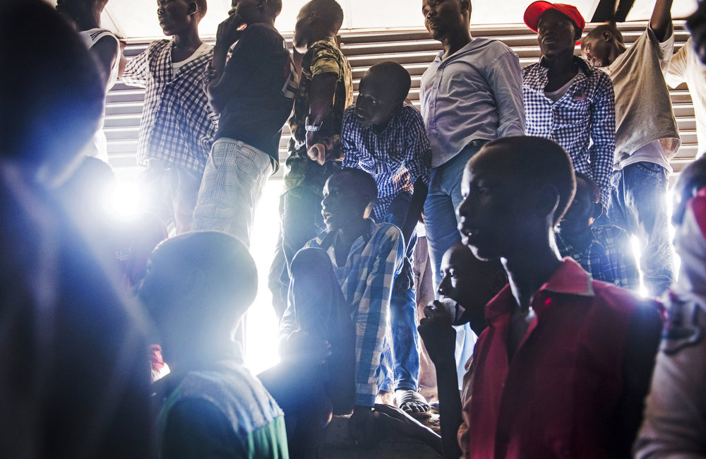 "Audience members look on while attending the ""Comedy for Peace"" event, supported by the United Nations Mission in South Sudan (UNMISS), at the Nyakuron Cultural Centre on Sunday, 23 April in Juba."