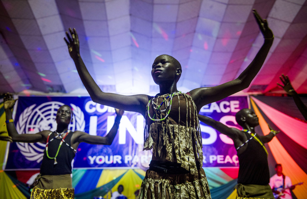 "Dancers perform with Emmanuel Kembe during the ""Comedy for Peace"" event, supported by the United Nations Mission in South Sudan (UNMISS), at the Nyakuron Cultural Centre on Sunday, 23 April in Juba."