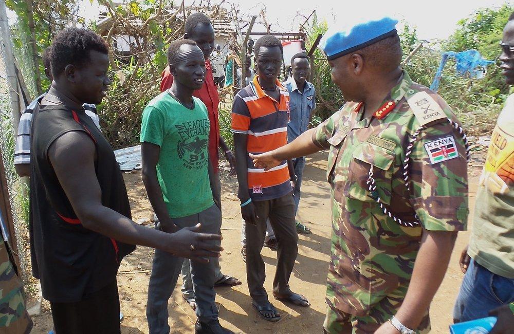UNMISS Force Commander - Lieutenant General John Mogoa Kimani Ondieke talks with IDP's outside of POC 1 in Juba.
