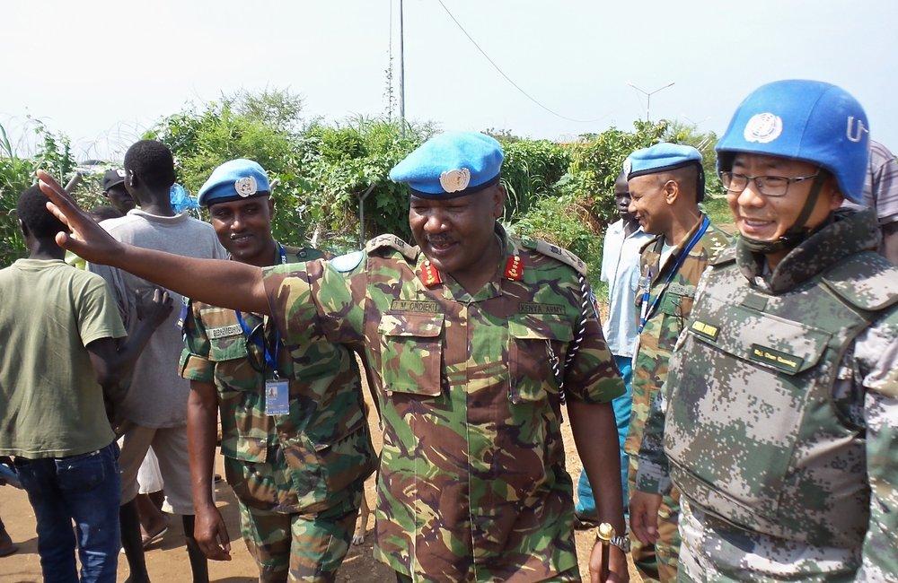UNMISS Force Commander - Lieutenant General John Mogoa Kimani Ondieke waves to IDP's as he leaves POC 1 in Juba.