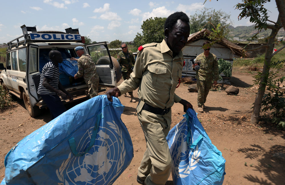 Int. Day of Peace 2016; Peacekeepers supply essential household goods to the village of Makituni on the outskirts of UN Base, Jebel area