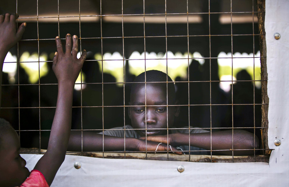 A young boy waits for the monthly rations at a food distribution site at the Imvepi refugee camp in Northern Uganda as on Friday, 23 June, 2017.