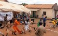 Imprisoned juvenile offenders in Torit play and learn outside prison on a rare free day