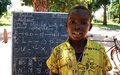 Lacking classrooms, returnee children in Ezo make do with informal lessons under trees