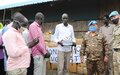 As South Sudan starts reopening schools, UNMISS peacekeepers from Mongolia hand over educational material to displaced children